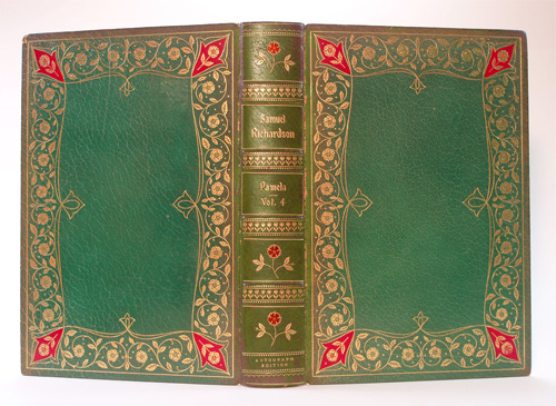 """A volume of the """"Pamela set, showing the onlaid corner pieces of the boards, and the onlaid roses of the spine. Again, the spine (sunned) has been retouched to approximate the green of the original state."""